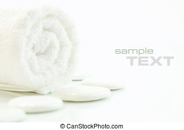 SPA settings - White pebbles and towel over white. Selective...