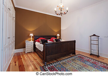Vintage master bedroom with wooden floor