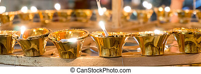 Golden electric lamps for Deepavali in India - Golden...