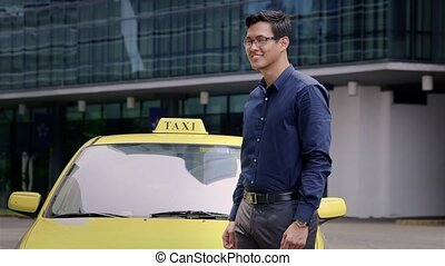 Young asian man as taxi driver