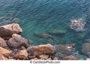 Wave water of sea near rock stone photo - Wave water of sea...