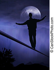 Dreamdancer - tightrope walker, artist is walking on a...