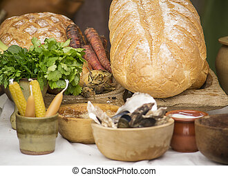 Medieval feast - Medieval food and vegetables on a table