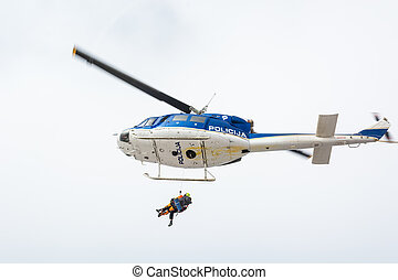 Mountain rescue helicopter - Rescuer and victim ascending...