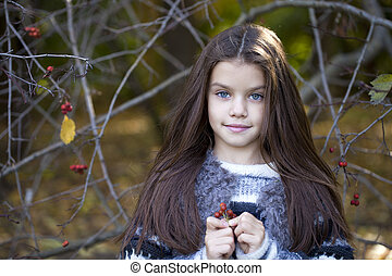 Beautifal little girl in the autumn park - Close up portrait...