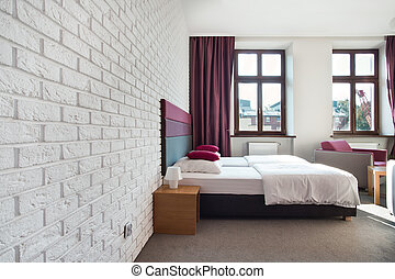 Interior of bright bedroom in the apartment