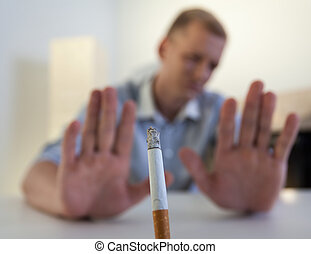 Man refuses to smoke a cigarette - The young man refuses to...