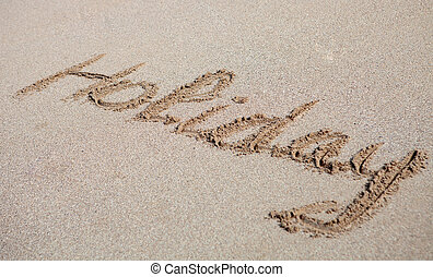 Holiday written on the sand