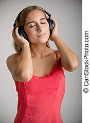 Woman Listening to Music - Young woman listening to music...