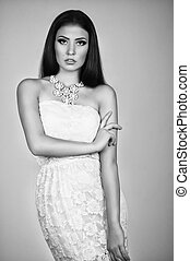 Fashionable young female in contemporary short dress. Studio...