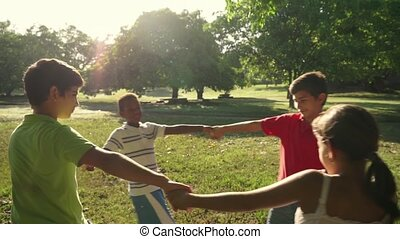 Children playing in park - Hispanic and african american...