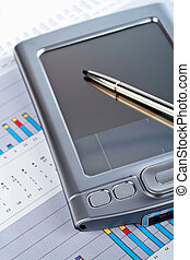 Personal digital assistant on market financial chart background
