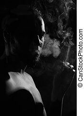 Smoker silhouette over black background