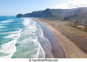 beach in new zealand - aerial view at piha beach from lion...