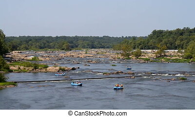 Rafting James River Virginia - Tourists raft down the James...