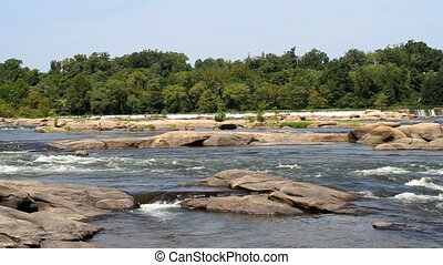 James River Virginia - White water rapids cascade down and...