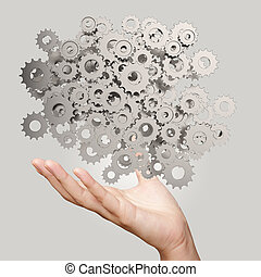 businessman hand showing  gears cogs to success concept