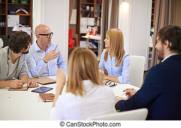 Business conversation - Business people communicating at...