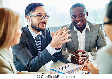 Hiring people - Happy Asian businessman looking at colleague...