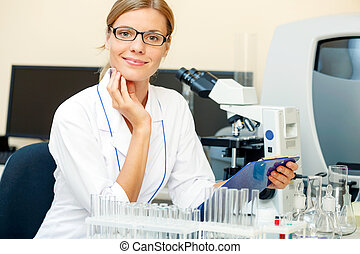 Portrait of beautiful young woman in a laboratory - Portrait...