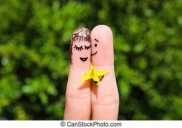 Finger art of a Happy couple Man is giving flowers to a...