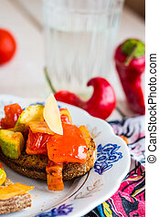 vegetarian snack rye sandwich with vegetables on a plate -...