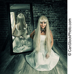 woman with big knife in mirror reflection - Young beautiful...