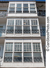 Vintage wooden balcony facade - Front view of Vintage wooden...