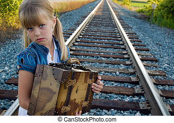 Going Away - Sad girl with old suitcase on railroad tracks