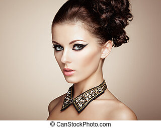Portrait of beautiful sensual woman with elegant hairstyle...