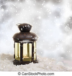 Christmas lantern on snowy background
