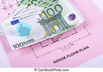 House and money on home plan background