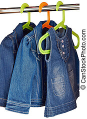 denim child clothes  hang  in a closet