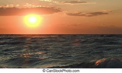 Golden sunset over rough sea - Beautiful golden sunset over...