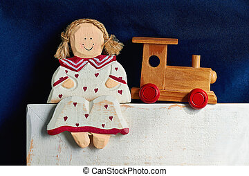 Wooden doll and train