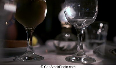 Pouring wine into empty glass in restaurant