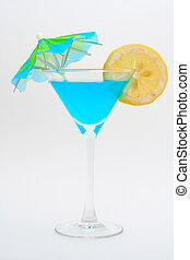 Detail of blue cocktail with lemon and umbrella - Blue...