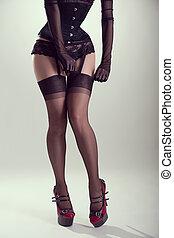 Pinup girl putting on nylon stockings