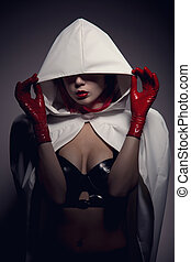 Portrait of sensual vampire girl with red lips wearing white...