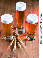 beer - glasses of beer on a rough wooden table