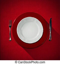 Empty White Plate with Cutlery - Empty and white plate with...