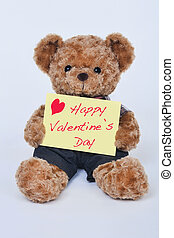Teddy, bear, holding, a, yellow, sign, that, says, Happy,...