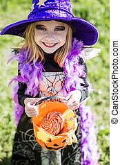 Trick or treat. Halloween character: beautiful little witch....