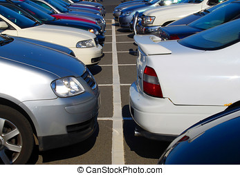 Crowded car park - Close-up of cars parked in crowded car...
