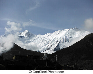 White Stupa before the Annapurna IV Himalayan Peak - A small...