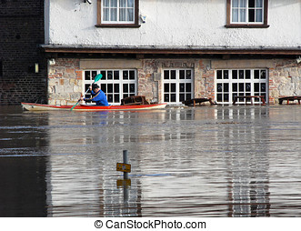 York Floods January 2008 - Canoeist paddles past flooded pub...