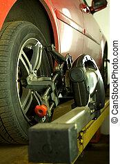 Car repair at service station - Red car repair at service...