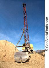 Big excavator with hard bucket