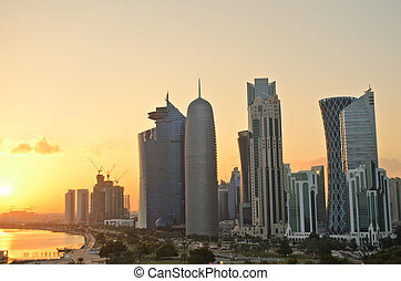 Doha at sunset - The skyscrapers in the skyline of the...