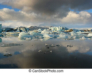 Storm over Jokulsarlon - Reflection of rainclouds and...